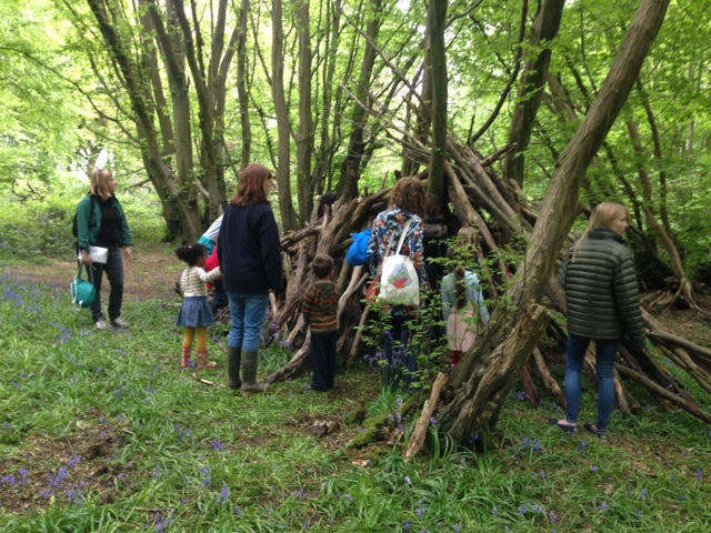 Children and adults making a den