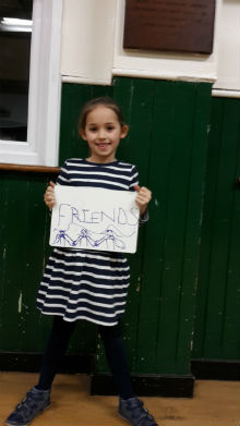 girl holding whiteboard